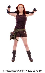 Beautiful redhead young woman with machinegun, holster and military outfit, isolated on white background