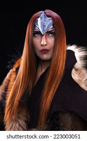 Beautiful redheaded girl as shieldmaiden,viking warrior woman