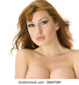 Beautiful redheaded topless woman pouting