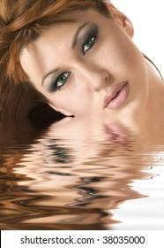 Beautiful redheaded woman reflected in water effect