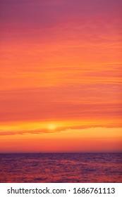 beautiful red-orange sunset on the sea, colorful sky and sea, magical landscape