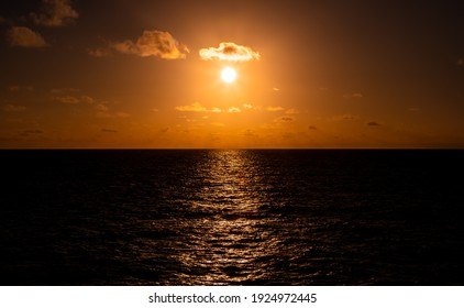 Beautiful refection orange,gold sunset with clouds over the  Pacific Ocean viewed from an ocean liner.