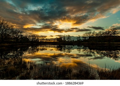 Beautiful reflection sunset and clouds in lake at Kampina Achterste Vennen Oisterwijk Netherlands