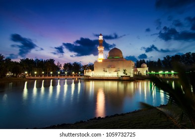 Beautiful reflection of Tengku Tengah Zaharah Mosque over sunrise background, most iconic floating mosque located at Terengganu Malaysia.