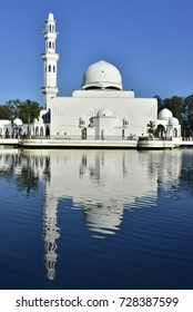Beautiful reflections of floating mosque in Terengganu with nice blue sky background.