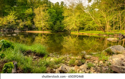Beautiful reflections on the waters of Eno River captured during summer. This is one of the best parks in Durham, North Carolina for nature hikes and camping, just few miles from Duke University.