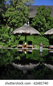 Beautiful reflections at a resort pool surrounded by green vegetation in Hue, Vietnam