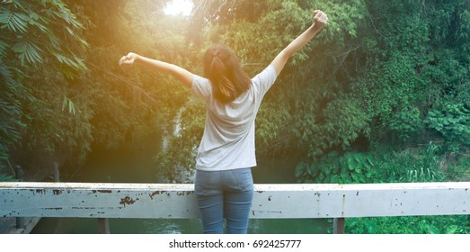 beautiful Refreshed woman in the forests And warm light