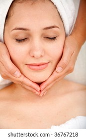 Beautiful relaxed woman getting a facial massage