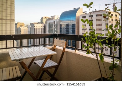 Beautiful relaxing balcony with plants view from a tower in the city