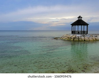 Beautiful and relaxing ocean sunset view of gazebo in Montego Bay Jamaica