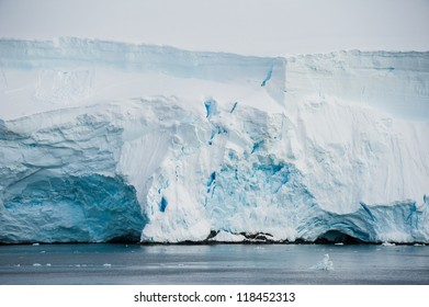 Beautiful relief iceberg in Antarctic bay