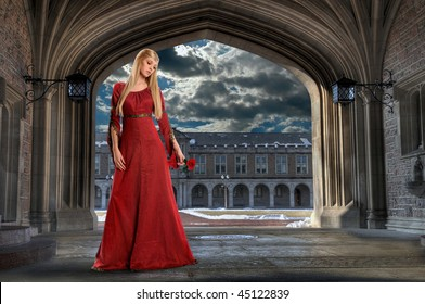 Beautiful Renaissance woman holding rose in ancient building