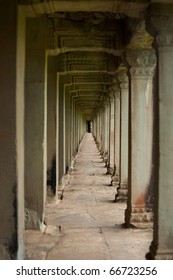 The beautiful repeating series of carved stone pillars and doorways of a hall that surrounds the inner wall of main Angkor Wat Temple in Siem Reap, Cambodia