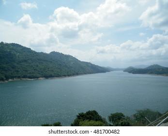 Beautiful Reservoir mountain and water on blue sky. Victoria tank in Kandy, Sri  Lanka