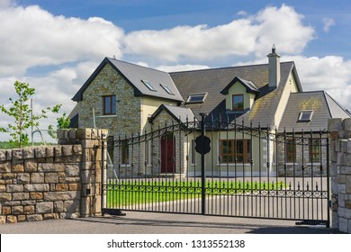 A beautiful residential house and artistic wrought iron gate.