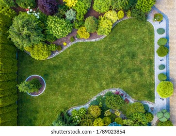 Beautiful Residential Mature Garden Aerial Top View Landscaping Industry Theme.