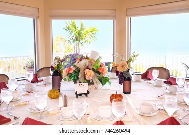 Beautiful restaurant event table setting in front of bright window