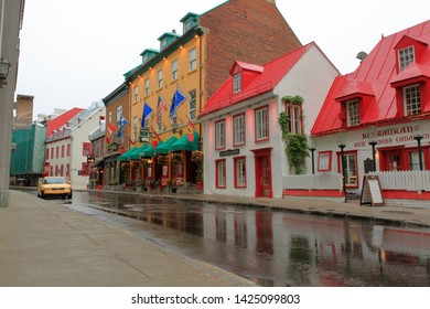 Beautiful restaurant and shopping buildings on Rue St Louis, or St Louis Road, inside the historic section of Old Quebec City - Quebec City, Quebec, Canada - June 13, 2019