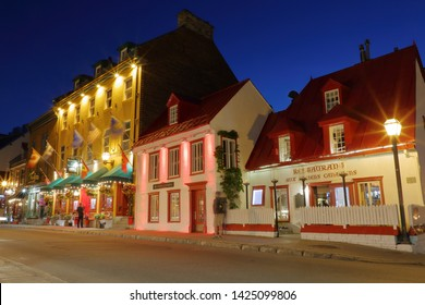 Beautiful restaurant and shopping buildings on Rue St Louis, or St Louis Road, inside the historic section of Old Quebec City - Quebec City, Quebec, Canada - June 12, 2019