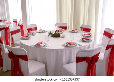 a beautiful restaurant table decorated with red ribbons, Chinese New Year, table number six, in anticipation of a banquet.
