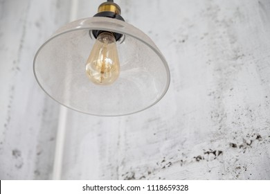 beautiful retro lighting decor on concrete wall background.