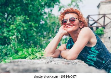 Beautiful retro older woman enjoying the view