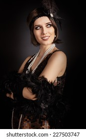 Beautiful retro woman from the roaring 20s ready to party - Vintage style image of a flapper girl