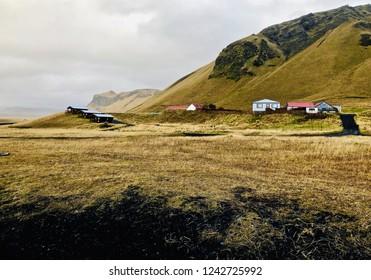 Beautiful Reynisfjara Black Sand Beach sunset: Vik Village, Iceland.