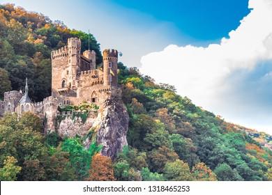 The beautiful Rheinstein Castle on hillside along the Rhine River in Germany