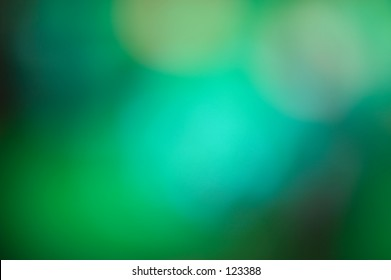 Beautiful rich background abstract in jewel toned color lights.