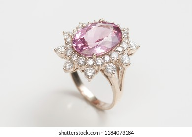 beautiful ring with pink amethyst gem (stone) isolated on white background