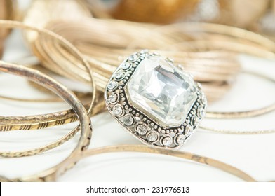 Beautiful rings and bangles on hand.Expensive Gold Jewelry background