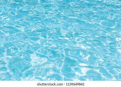 Beautiful ripple wave and blue water surface in swimming pool, Blue water for background and abstract