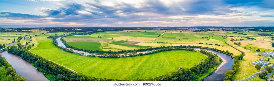 Beautiful river bends in agricultural land in Australia - wide aerial panorama