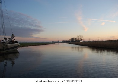 beautiful river with cloured sky and sun in the background