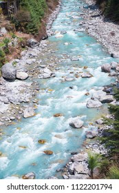 Beautiful river and mountains landscape in forest during trekking route to the Everest Base Camp in Nepal