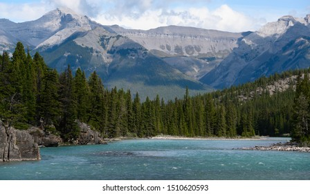 Beautiful river in the mountians with forests surrounding it