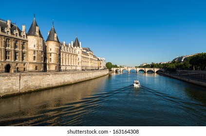 The beautiful River Seine in Paris, France with boat cruising by.