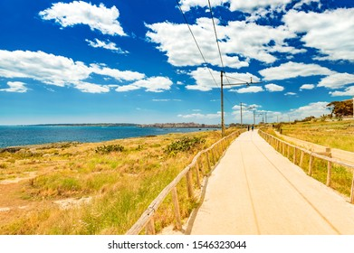 Beautiful road along the coastline of Syracuse. Former railway track, Sicily, Italy