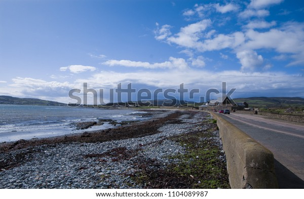 Beautiful  road and beach in with clear blue sky in Isle Of Man.