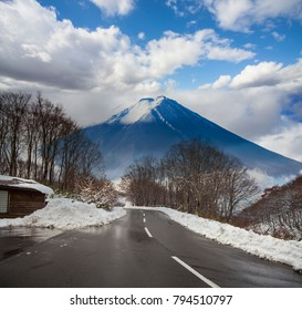The beautiful road in mountain with nice view of snow in Spring