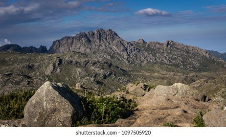 Beautiful rock mountain in the background and some rocks at front, illuminated by the sun light.