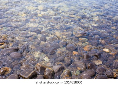 Beautiful rock pattern on beach with clear sea water in Lipe island, Satun province, Thailand