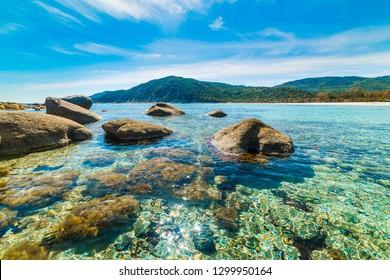 Beautiful rocks in Cala Pira clear water. Sardinia, Italy