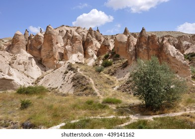 Beautiful rocks formations and fairy chimneys near Ortahisar in the Cappadocia or Kapadokia region, Turkey, Europe, Asia