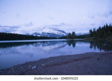 Beautiful Rocky Mountain landscape at dawn at Lake Minnewanka in Banff National Park Alberta Canada