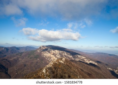 Beautiful rocky mountain peak, forests colored with late autumn colors and blue sky with soft clouds over Vlaska planina in Serbia, near village Vlasi - Shutterstock ID 1581834778