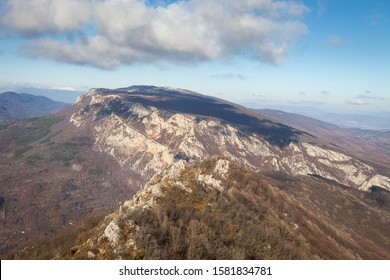 Beautiful rocky mountain peak, forests colored with late autumn colors and blue sky with soft clouds over Vlaska planina in Serbia, near village Vlasi - Shutterstock ID 1581834781