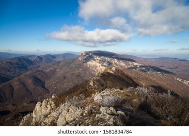 Beautiful rocky mountain peak, forests colored with late autumn colors and blue sky with soft clouds over Vlaska planina in Serbia, near village Vlasi - Shutterstock ID 1581834784